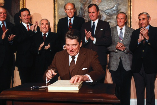Ronald Reagan signs the Immigration and Control Act of 1986.