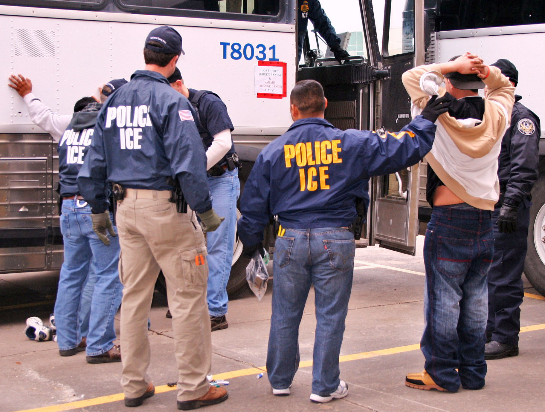 ICE Special Agents (U.S. Immigration and Customs Enforcement) arresting suspects during a raid. Photo Courtesy of ICE.