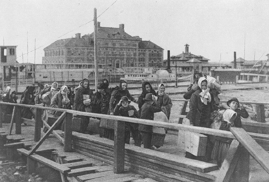 Immigrants arriving at Ellis Island, 1902. United States Library of Congress's Prints and Photographs division under the digital ID cph.3a14957