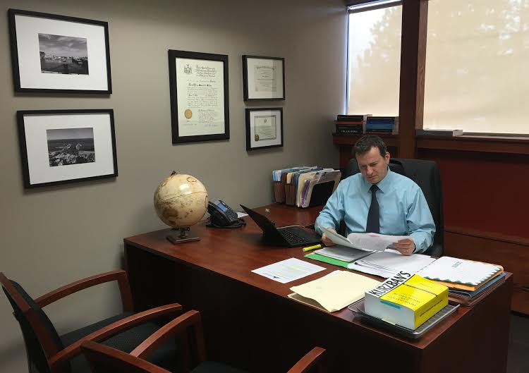 Attorney Marcel Miclea working at his desk, December 2015